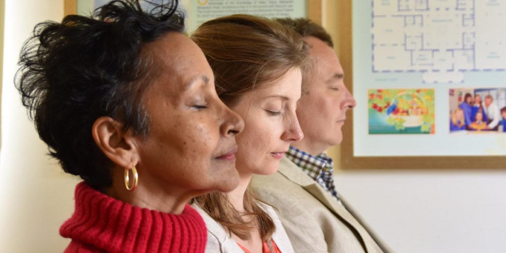 Three people meditating